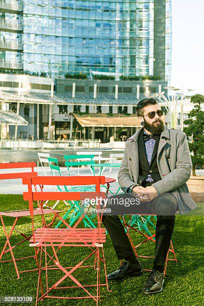 Stylish Hipster sitting outdoor