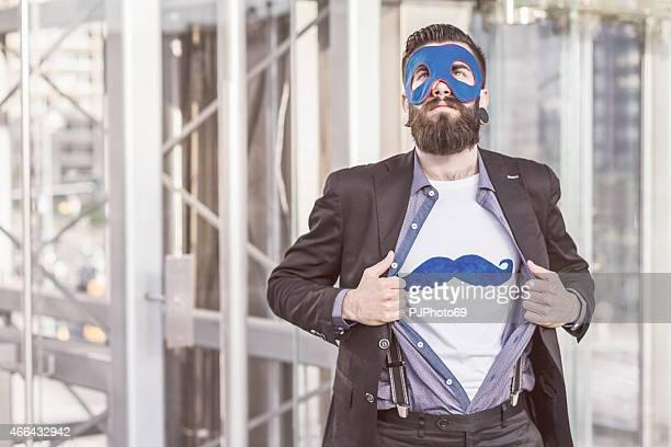 Stylish Hipster superhero showing mustaches on t-shirt