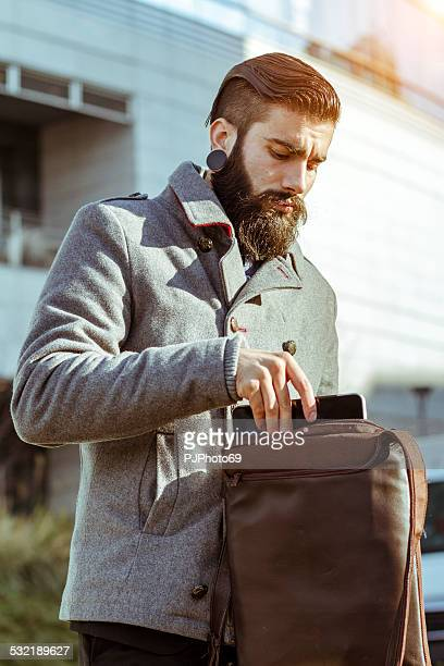 stylish hipster with his canvas shoulder bag - pjphoto69 stock pictures, royalty-free photos & images