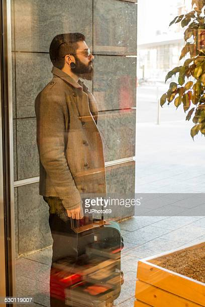 stylish hipster with luggage standing outdoor - pjphoto69 stock pictures, royalty-free photos & images