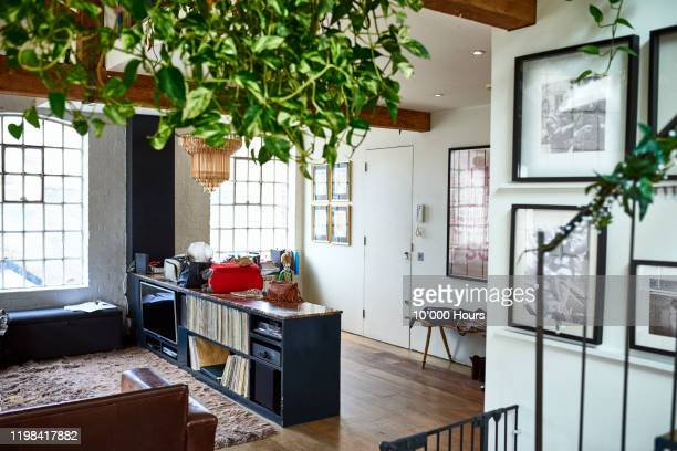 stylish home interior in contemporary urban building - house stock pictures, royalty-free photos & images