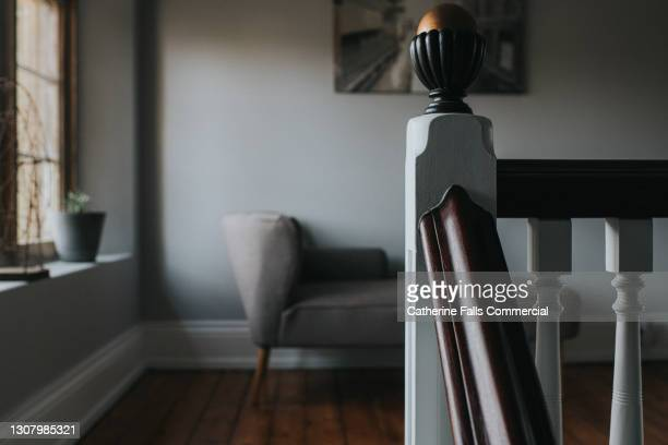 stylish interior, focusing on the wooden bannister - luxury stock pictures, royalty-free photos & images