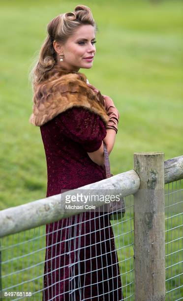 Stylish lady spectator wearing fur stole trackside at Goodwood on September 8th 2017 in Chichester England