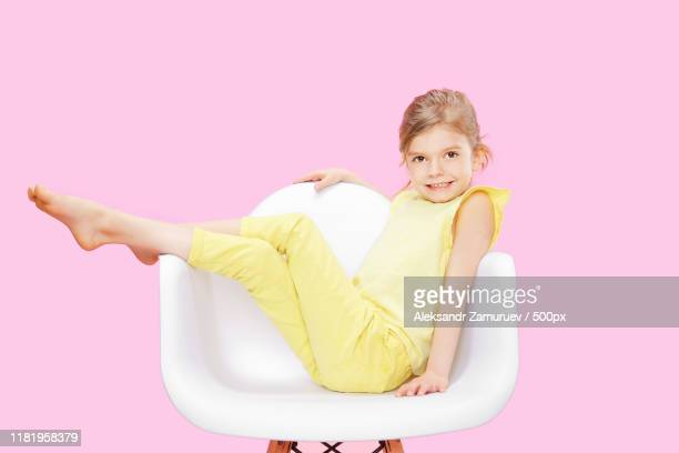 stylish little girl in yellow n pink - n n girl model stock photos and pictures