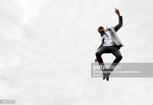 Stylish man in mid-air