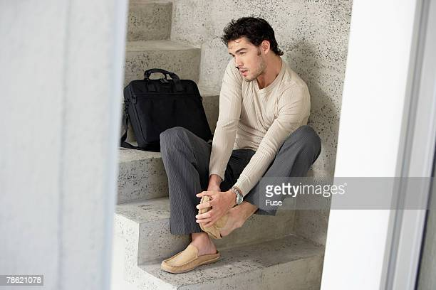 Stylish Man Putting on Shoes