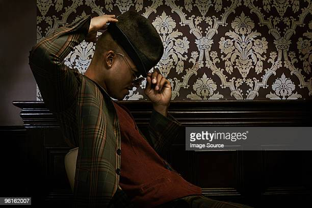 stylish man wearing fedora - black sexual stock photos and pictures