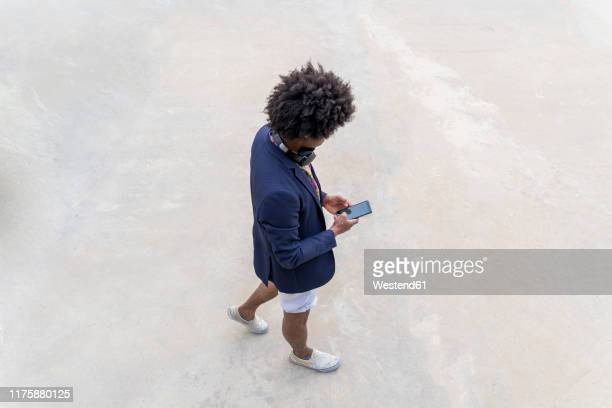 stylish man with cell phone on the go - funky stock pictures, royalty-free photos & images