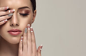 Stylish manicure and make up in a pale-pink color.