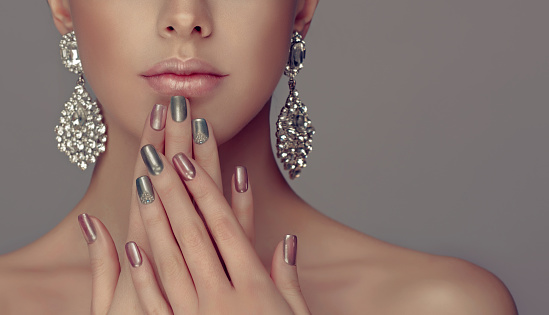 Stylish manicure and make up in a silver color. 845523762