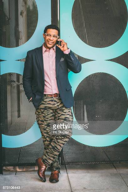 stylish mixed race businessman talking on cell phone outdoors - handsome native american men stock pictures, royalty-free photos & images