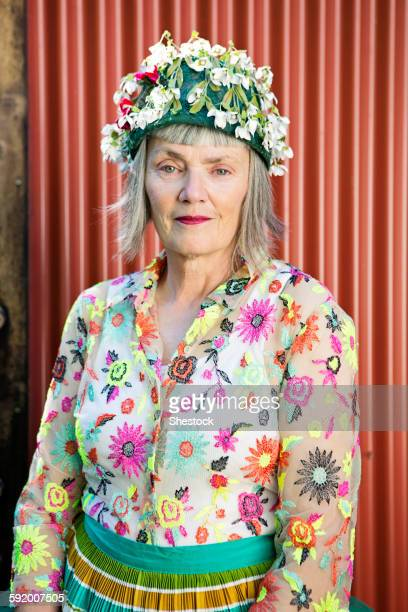 Stylish older Caucasian woman wearing floral cap