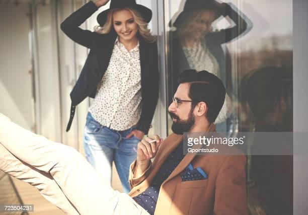stylish photographers taking a cigarette break on photography studio balcony - pause machen stock-fotos und bilder
