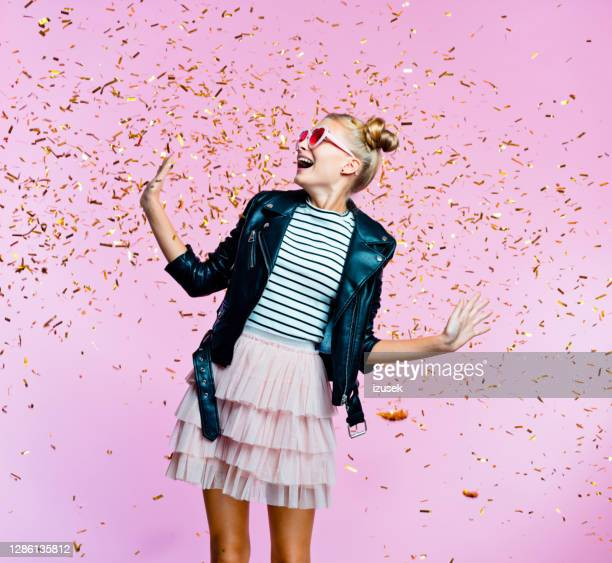 stylish pretty teenege girl among gold confetti - embellished jacket stock pictures, royalty-free photos & images