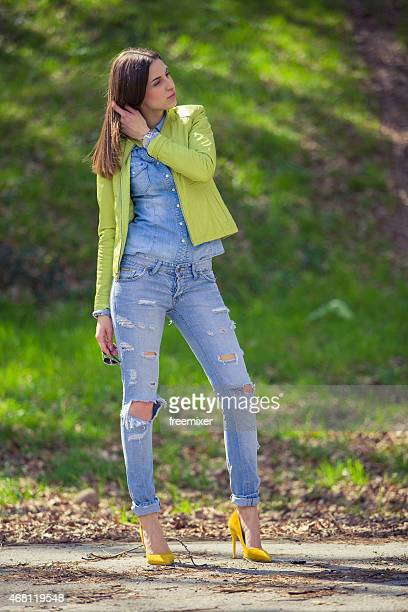 stylish pretty woman - ripped jeans stock photos and pictures