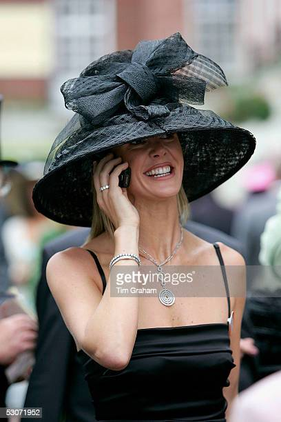 A stylish racegoer in traditional Ascot fashion hat speaks on her mobile phone at the second day of Royal Ascot 2005 at York Racecourse on June 15...