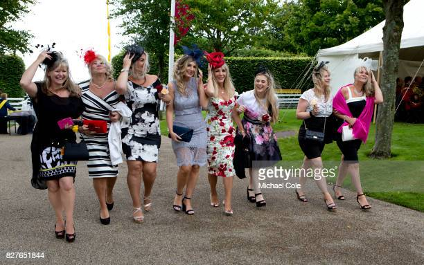 Stylish Racegoers arriving on 'Ladies Day' at 'Glorious Goodwood' The Qatar Goodwood Festival at Goodwood Racecourse August 3 2017 in Chichester...