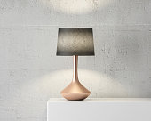 Stylish table lamp mockup with black shade and gold stand on white table