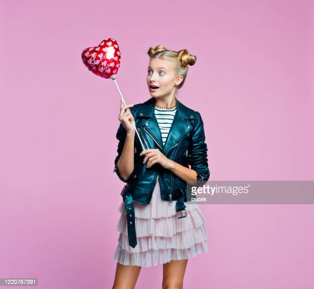 stylish teenege girl holding heart shaped balloon - embellished jacket stock pictures, royalty-free photos & images