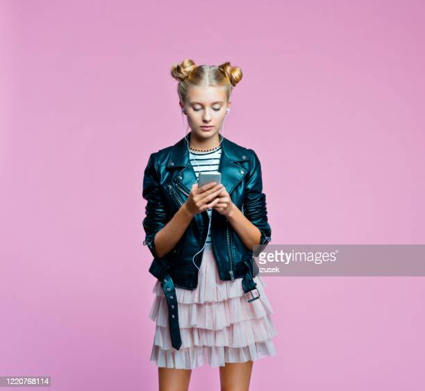 stylish teenege girl using smart phone - text stock pictures, royalty-free photos & images