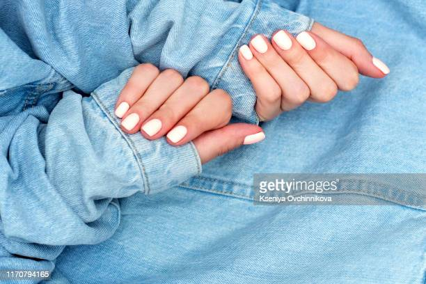 stylish trendy female manicure. beautiful young woman's hands on pink and blue background. - nail polish stock pictures, royalty-free photos & images