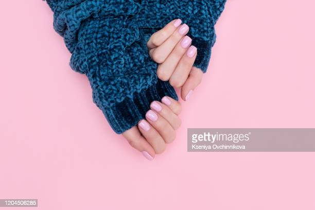stylish trendy female manicure. beautiful young woman's hands on pink and blue background. - oval kennington stock pictures, royalty-free photos & images