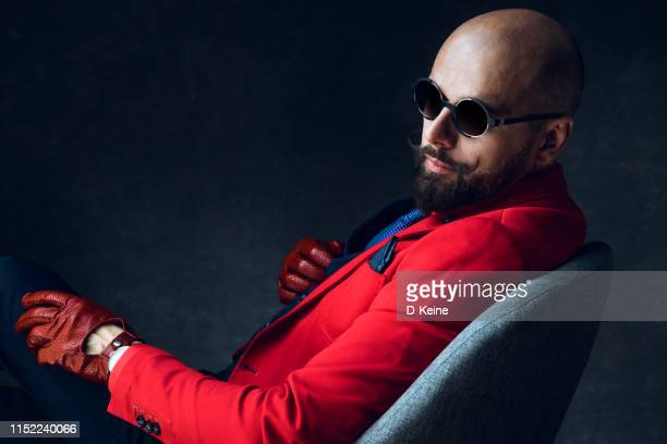 stylish well dressed gentleman having photoshooting in studio - best sunglasses for bald men stock pictures, royalty-free photos & images