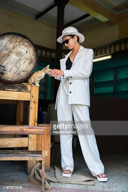 woman white suit white hat stroking
