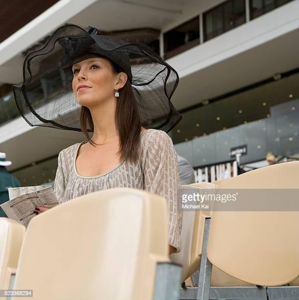 Stylish woman at horse race