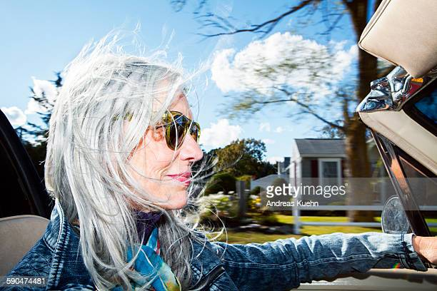 stylish woman driving a convertible. - massachusetts stock pictures, royalty-free photos & images