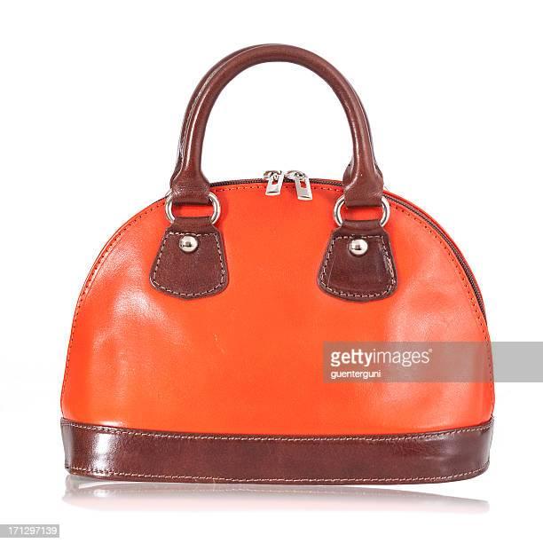 Stylish woman handbag in orange and brown
