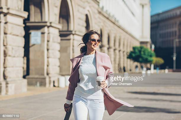 Stylish woman in a hurry