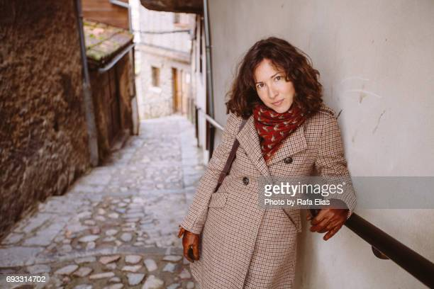 Stylish woman in alley
