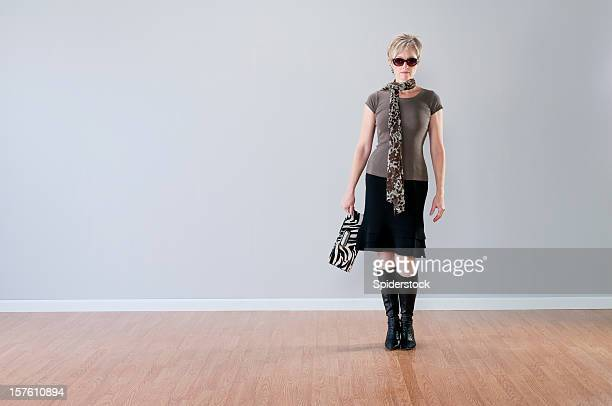 stylish woman in empty room - wainscoting stock photos and pictures