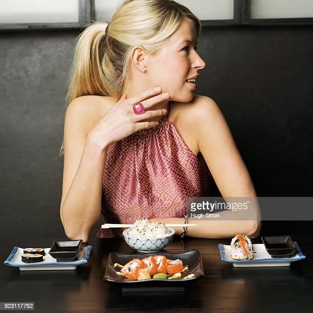 stylish woman in japanese restaurant - hugh sitton stock-fotos und bilder
