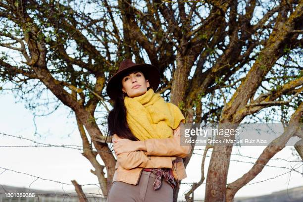 stylish woman in scarf and cowboy hat - neckwear stock pictures, royalty-free photos & images