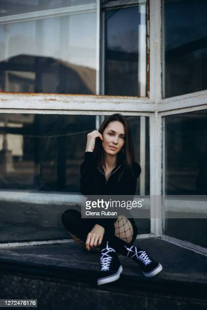 stylish woman in shorts, black stockings and sweatshirt - models in stockings stock pictures, royalty-free photos & images