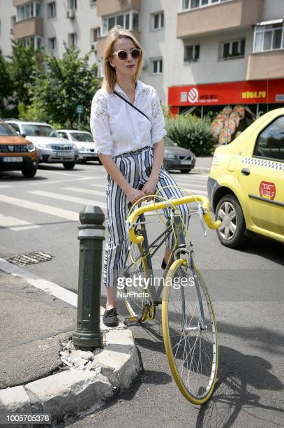 A stylish woman is seen on a racing bike in central Bucharest Romania on July 25 2018