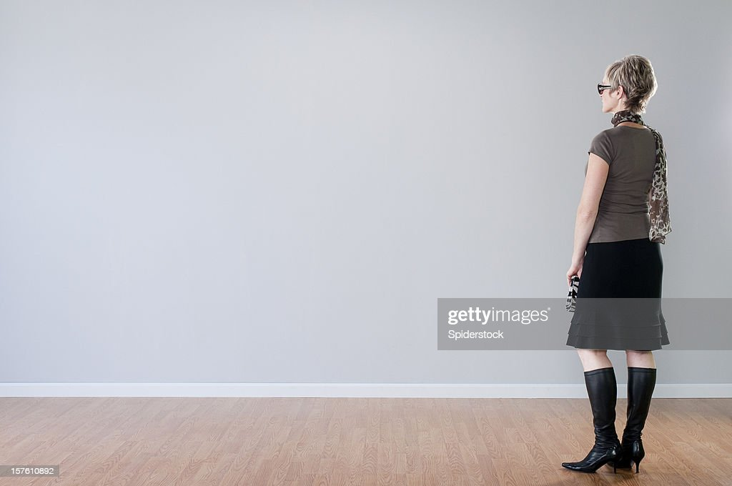 Stylish Woman Looking At Blank Wall : Stock Photo