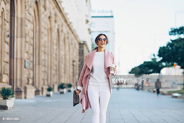 stylish woman on the square - work shoe stock photos and pictures