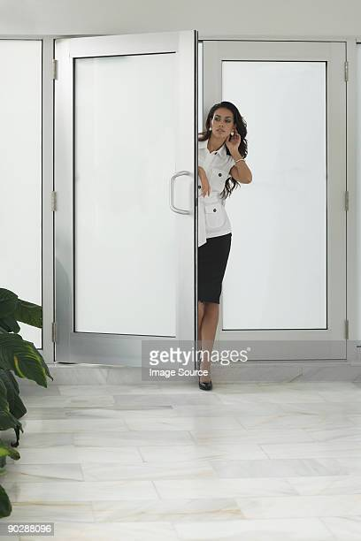 Stylish woman opening door