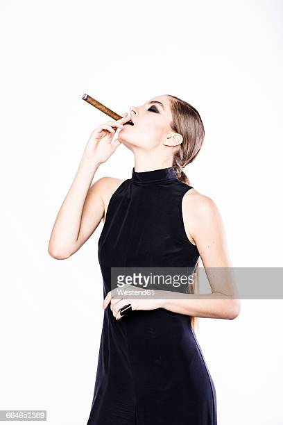 stylish woman smoking a cigar - beautiful women smoking cigars stock photos and pictures