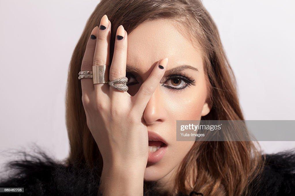 Stylish Woman Touching her Face Sensually : Stock Photo