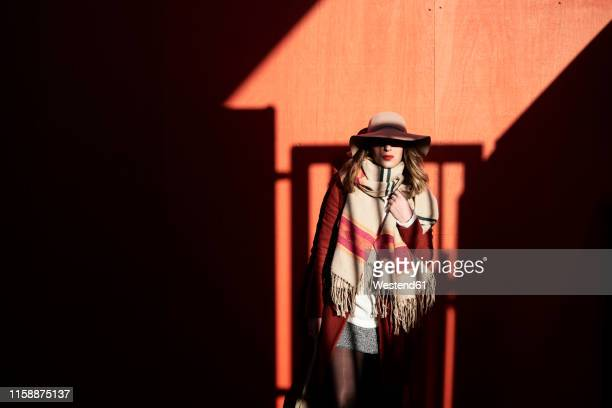 stylish woman wearing a floppy hat in light and shadow - shadow stock pictures, royalty-free photos & images