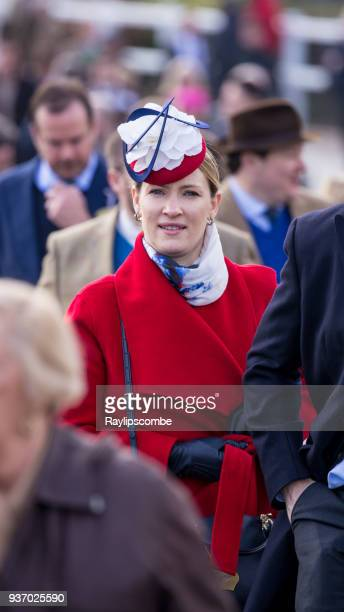 Stylish woman wearing a red, white and blue fascinator, mingling with the large crowds on her way to the world famous Cheltenham Festival Horse Races