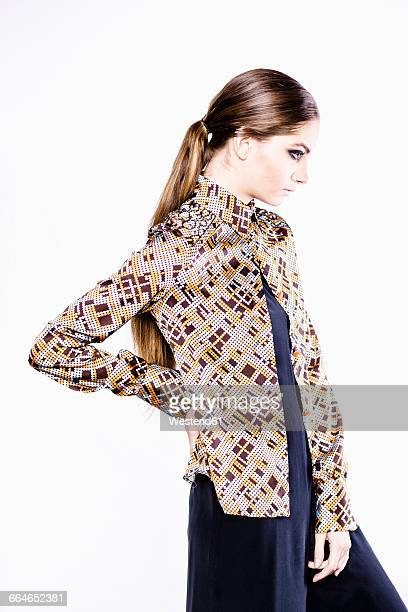 Stylish woman wearing patterned blouse