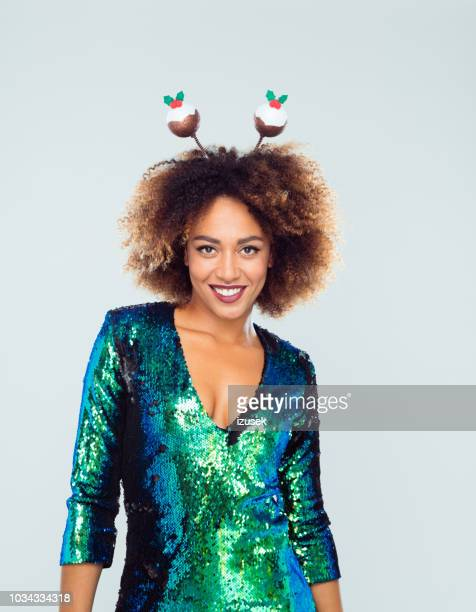 stylish woman with funny christmas headband - sequin dress stock pictures, royalty-free photos & images