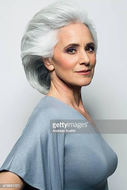 Stylish woman with grey hair, portrait.