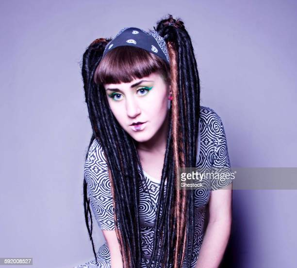 Stylish woman with makeup and dyed dreadlocks