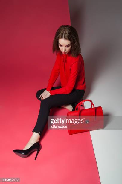 stylish woman with red bag - multi coloured purse stock photos and pictures
